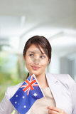 cutcaster-photo-100878569-Pretty-young-female-looking-away-Australian-flag.jpg