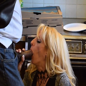 Mature housewife in the kitchen