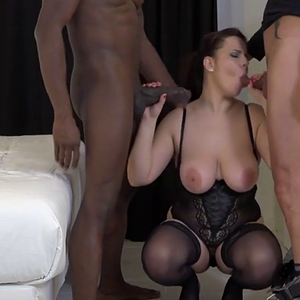 Thick busty lady fucks black and white cocks