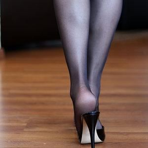 Walking in black mules and black pantyhose