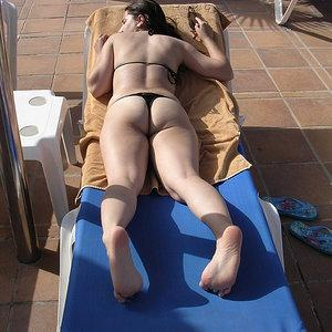 Tanning in black thong bikini