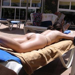 Tanning in black thong