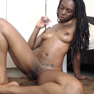Oiling Up Her Beautiful Brown Body