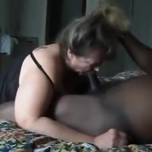 Mature woman sucks a BBC for a happy ending.