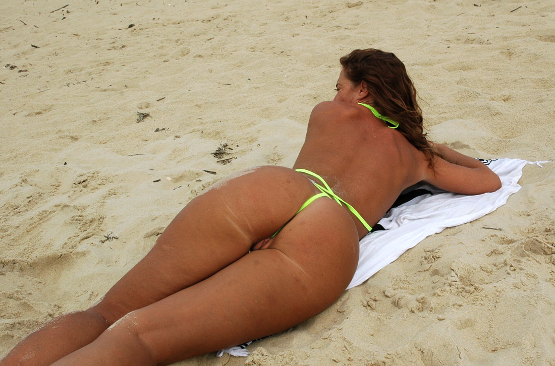 Nude women in thongs on the beach — pic 13
